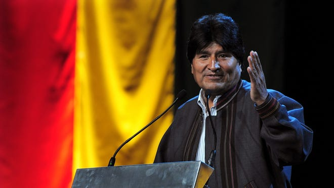 """Bolivia's President Evo Morales gives a speech during the """"International Meeting with Social Movements"""" in Barcelona on December 9."""