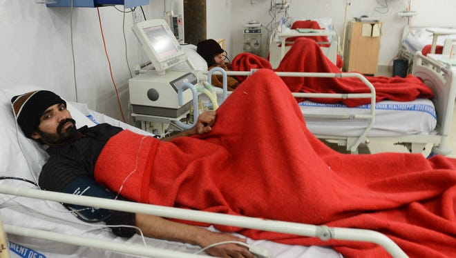 Pakistani patients who consumed toxic cough syrup are treated in a ward of a hospital in Gujranwala, Pakistan, Saturday.