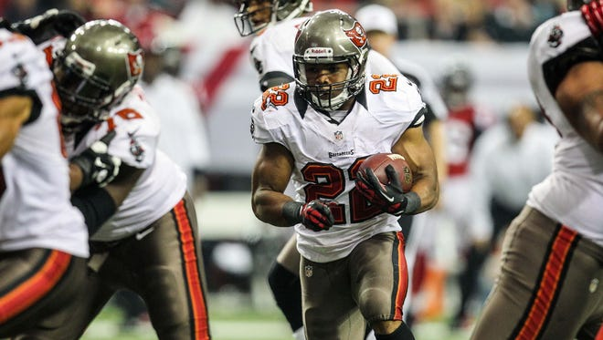 Tampa Bay Buccaneers running back Doug Martin (22) looks for daylight the Atlanta Falcons at the Georgia Dome in Atlanta on Dec. 30, 2012. Martin posted his sixth 100-yard rushing game of the season.