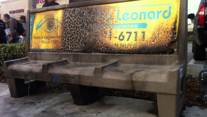 A burned city bus bench seen in the Van Nuys section of Los Angeles on Thursday after police arrested a man for allegedly setting a 67-year-old woman on fire who was sleeping on the bus stop bench. A