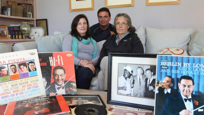 Gina, Carmen and Elizabeth Lombardo are surrounded by memorabilia of their uncle, big band leader Guy Lombardo on December 21 in Fort Myers, Fla.