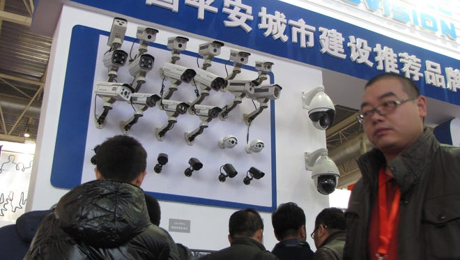 Surveillance cameras attract potential customers at Security China 2012, a large trade show in the Chinese capital, Beijing.