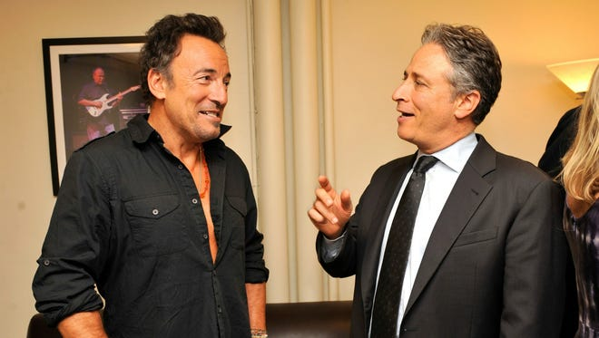 """Bruce Springsteen and Jon Stewart backstage at """"Stand Up for Heroes""""  at the Beacon Theatre."""
