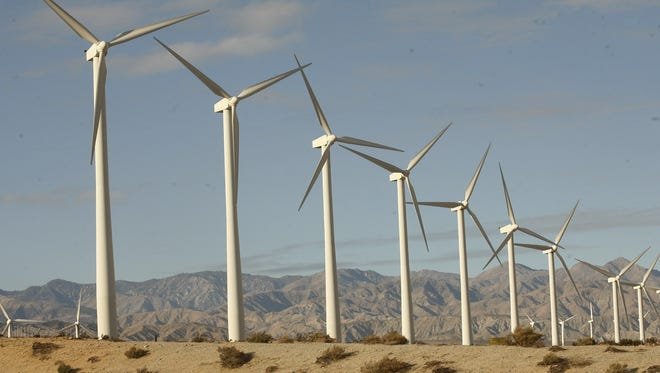 Wind turbines create electricity Jan. 1 in north Palm Springs, Calif. A one-year extension of a key tax credit for the wind industry was included in the fiscal cliff deal Congress passed.