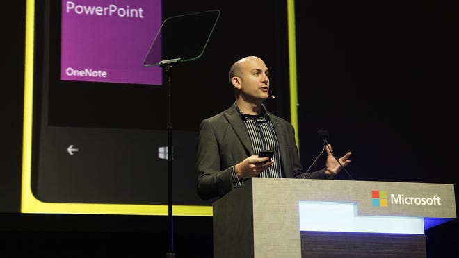 Ryan Asdourian, Microsoft Corp. Senior Product Manager for Windows, demonstrates the Windows 8 operating system running on a Nokia mobile phone as he speaks during Microsoft's annual meeting of shareholders, Nov. 28, 2012, in Bellevue, Wash.