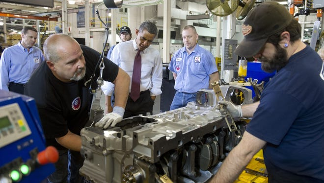 President Obama talks with workers during a tour of the Daimler Detroit Diesel Plant in Redford, Mich., on Dec. 10.
