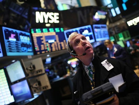 traders work on the floor of the new york stock