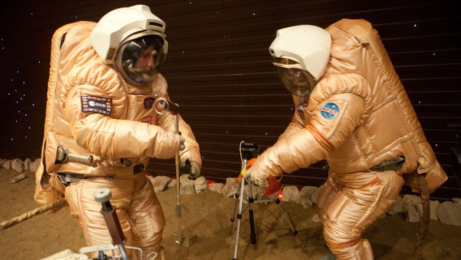 Crew train for 'Marswalk' on the simulated Martian terrain of the Mars500 experiment.