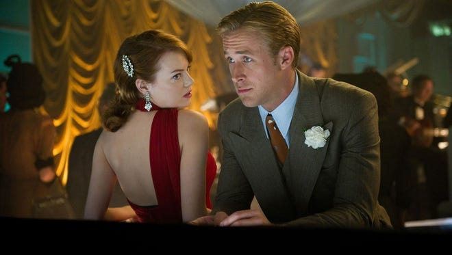 Emma Stone, left, and Ryan Gosling star in the unconvincing and cartoonish 'Gangster Squad.'