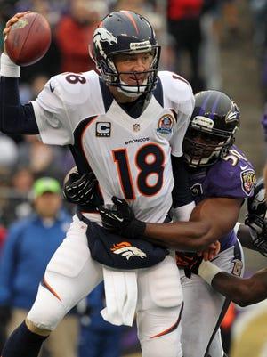 Denver Broncos quarterback Peyton Manning is sacked by Baltimore Ravens linebacker Albert McClellan  at M&T Bank Stadium in Baltimore on Dec. 16, 2012.