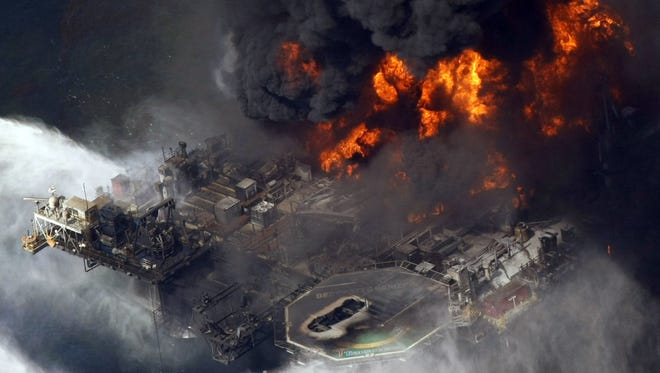 The Deepwater Horizon oil rig burns in the Gulf of Mexico in 2010.