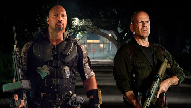 Dwayne Johnson, left, as 'Roadblock'  and Bruce Willis as 'Colton' in 'G.I. Joe: Retaliation,' which is now scheduled for a March 29 release.