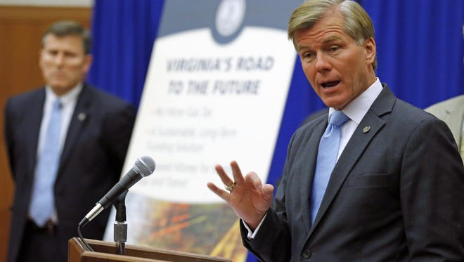 Virginia Gov. Bob McDonnell talks about eliminating the state gasoline tax in return for an increase in the state sales tax Tuesday in Richmond, Va.