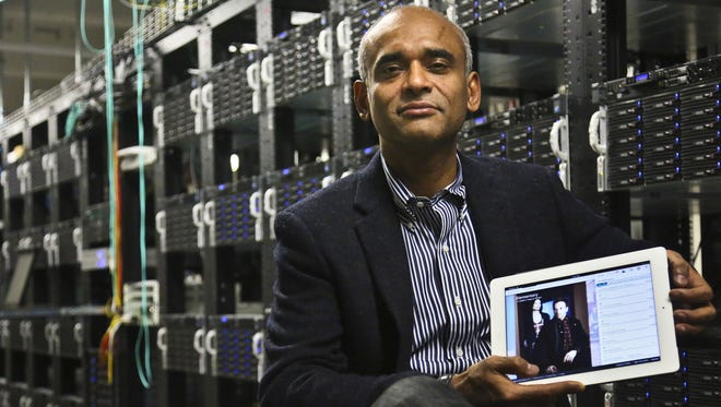 Chet Kanojia, founder and CEO of Aereo,  shows a tablet displaying his company's technology.