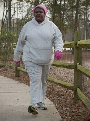 Clarisse Spriggs, 61, walks through Heritage Park in Simpsonville, S.C. on January 4.