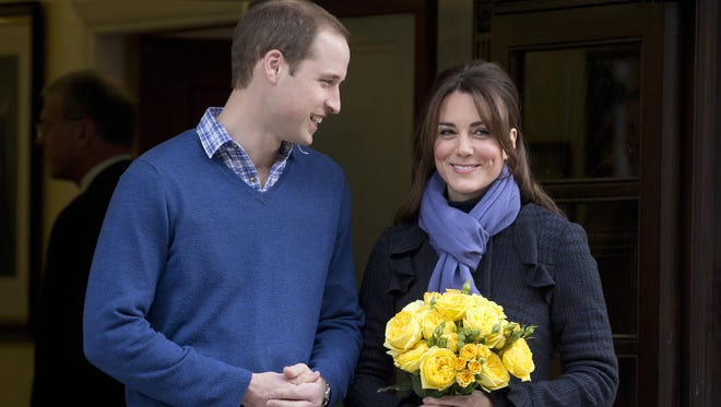 Britain's Prince William stands next to his wife Kate, Duchess of Cambridge, as she leaves the King Edward VII hospital in central London late last year.