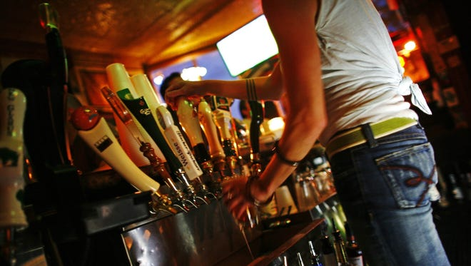 A bartender pours a beer at the Nomad Pub on Aug. 25, 2006, in Milwaukee, Wisconsin.