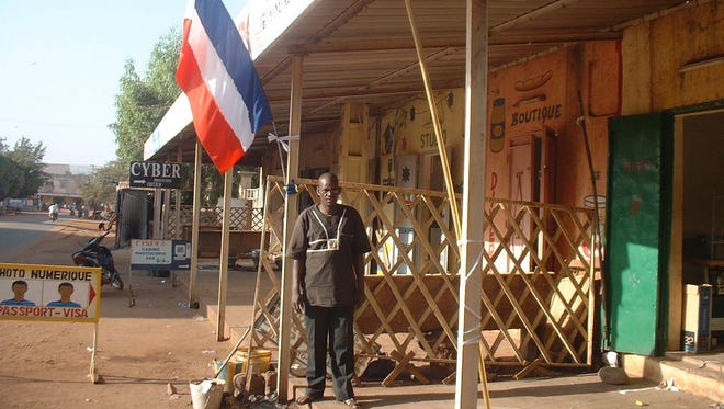 Abdourahamane Abidine, a tailor, fled Timbuktu three months ago after Islamists took control of the ancient city. He says that displaying the tricolor French flag outside his new shop in the Malian capital of Bamako is a way of showing support for the French troops that have arrived to prevent the rebels advancing into the south of his country.