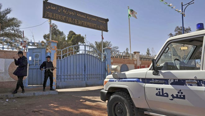 Officers guard the entrance to a hospital located near the gas plant where hostages were kidnapped by Islamic militants in Ain Amenas, Algeria, on Saturday.