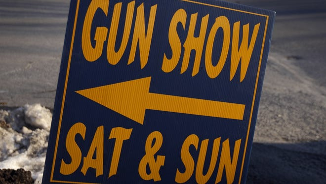 A Friday, Jan. 4, 2013, file photo shows a sign posted for an upcoming gun show, in Leesport, Pa.