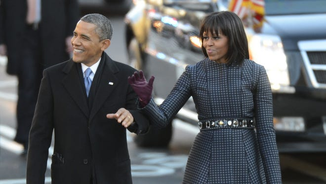 President Obama and first lady Michelle Obama walk down Pennsylvania Avenue during the inaugural parade Monday.