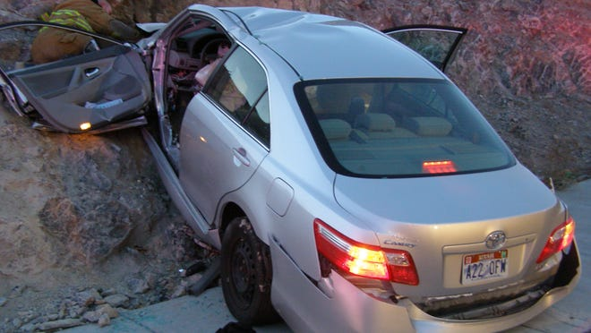 A Nov. 5, 2010 photo released by the Utah Highway Patrol of a Toyota Camry that crashed as it exited I-80 in Wendover, Utah. Police suspected problems with the Camry's accelerator or floor mat in the crash that left two people dead and two others injured. Toyota recently settled a lawsuit over the crash.