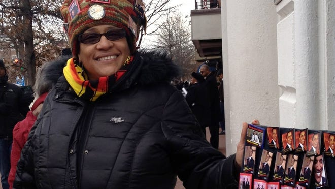 Lafern Love, 45, a psychotherapist from Peeksill N.Y.,  sells inauguration pins designed by a college friend Jan. 21 in Washington.