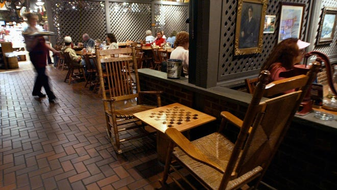 Cracker Barrel customers shop and eat at the restaurant in Nashville, Tenn., in 2006.