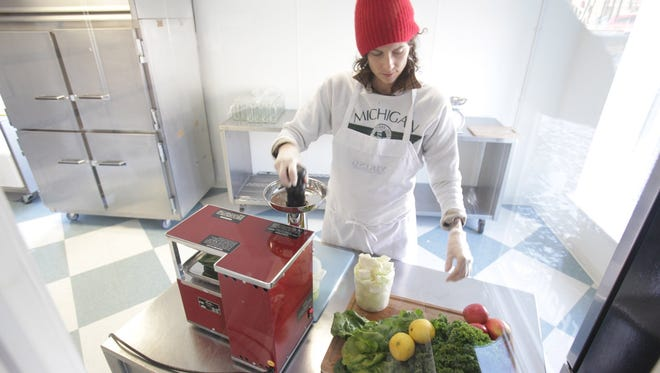 Jessie James adds a cucumber to a green juice at Drought in Plymouth, Mich., on January 22.