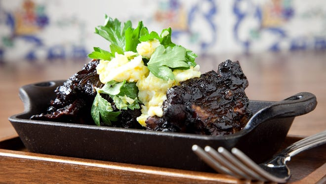 Pig's Tails Braised in Balsamic with Grated Egg & Parsley at Chicago's The Purple Pig. The dish, along with a crispy pig ear offering, is very popular. (Gannett/File)