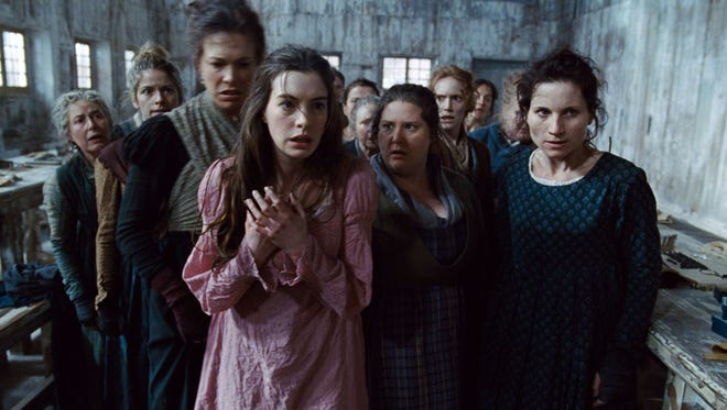 There appears to be a divide between some top-name critics and audiences over the quality of 'Les Miserables,' starring Anne Hathaway, center.