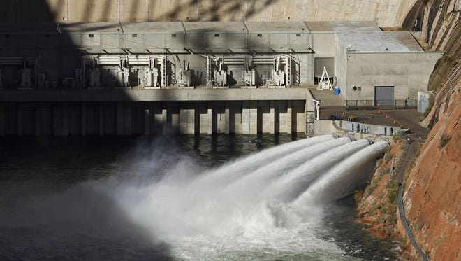 The Colorado River is flooded November 19  from bypass tubes at Glen Canyon Dam in Page, Ariz.