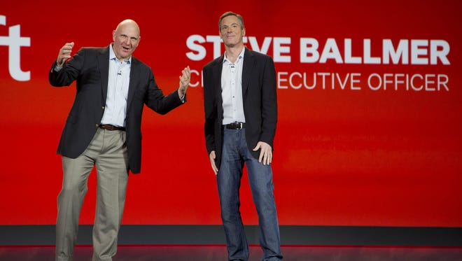 Microsoft CEO Steve Ballmer, left, and Qualcomm CEO Paul Jacobs speak during Jacobs' keynote address at the Consumer Electronics Show in Las Vegas.