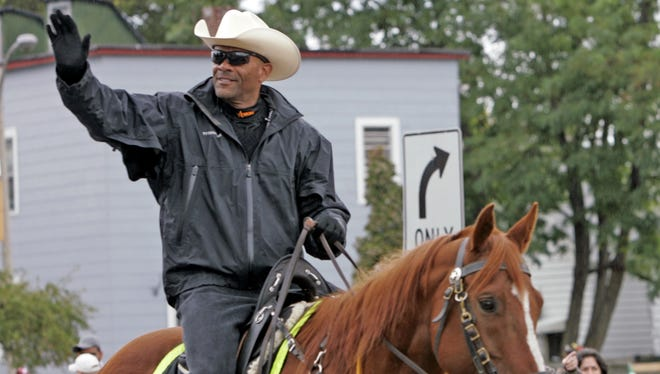 In this 2010 photo, Milwaukee County Sheriff David Clarke Jr. rides his horse during the Mexican Independence Day Parade in Milwaukee, Wis.