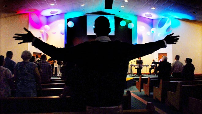 Ernest Adulai worships at Praise Cathedral Church of God in Melbourne, Fla.