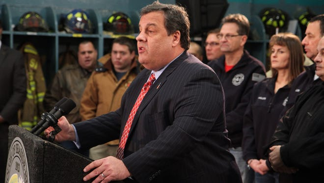 Gov. Chris Christie unveils his new flood map regulation at the Seaside Heights (N.J.) Volunteer fire department on January 24.