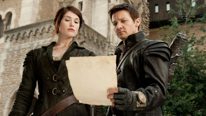 Jeremy Renner, right, and Gemma Arterton are the titular stars of the unimaginative 'Hansel & Gretel: Witch Hunters.'