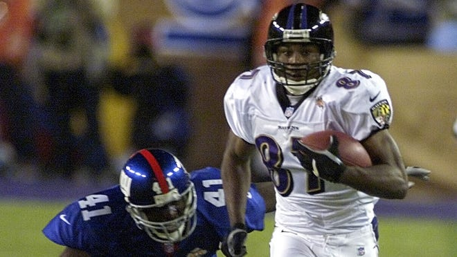 Baltimore Ravens wide receiver Qadry Ismail hauls in a 44-yard pass against the New York Giants in Super Bowl XXXV in Tampa Bay on Jan. 28, 2001.