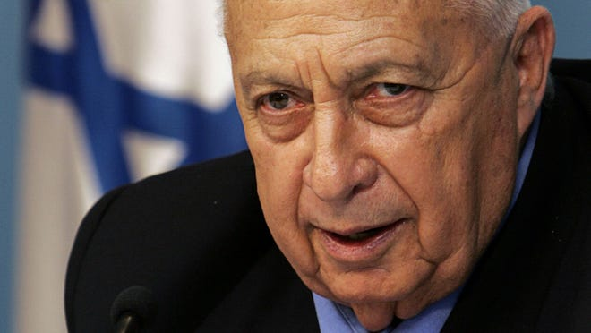 Israeli Prime Minister Ariel Sharon holds a press conference in 2005 at his office in Jerusalem.