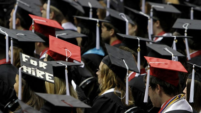 In this Aug. 6, 2011, file picture, students attend graduation ceremonies at the University of Alabama in Tuscaloosa, Ala.
