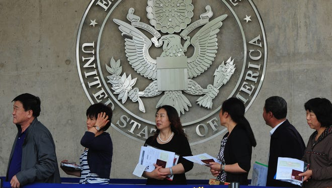 Chinese citizens wait to submit their visa applications at the U.S. Embassy in Beijing in May.