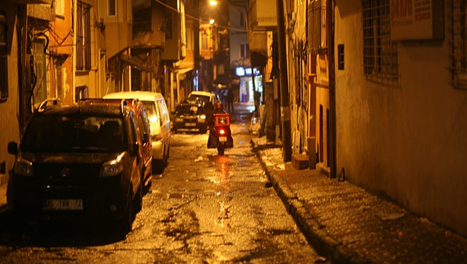 A street in the Tarlabasi neighborhood, a part of the Beyoglu district, where Sarai Sierra stayed, ís marked by old, run-down buildings, broken pavement and strewn trash.