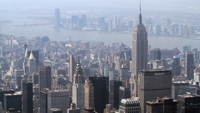 New York city buildings are seen against a hazy backdrop last summer. Heat rising up from cities such as New York, Paris and Tokyo might be remotely warming up winters far away in some rural parts of Alaska, Canada and Siberia.