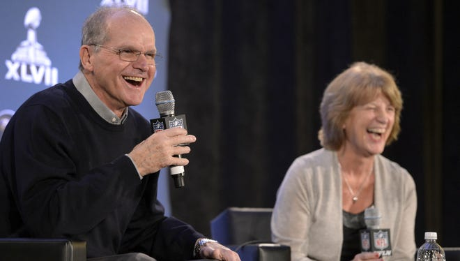Jack Harbaugh and his wife Jackie Harbaugh talk to the media during a press conference at the New Orleans convention center about their coaching sons John (Ravens) and Jim (49ers).