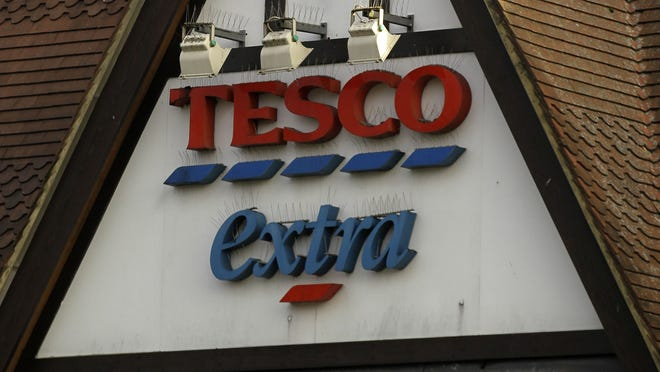 A sign of Tesco supermarket is seen at a branch in Purley, south London, Wednesday, Jan. 16, 2013.