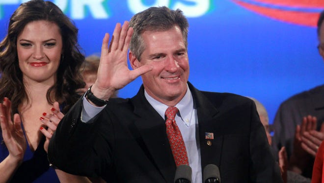 Republican Scott Brown waves to supporters in Boston on Nov. 6, 2012, after conceding the Massachusetts Senate race to Democrat Elizabeth Warren.