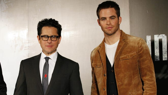 "Director J.J Abrams and actor Chris Pine pose for photos during a press conference for their latest film ""Star Trek Into Darkness."" in Tokyo, Tuesday, Dec. 4, 2012."