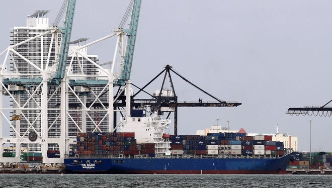 In this Tuesday, Nov. 13, 2012 photo, the container ship HS Bach is shown docked at the Port of Miami.
