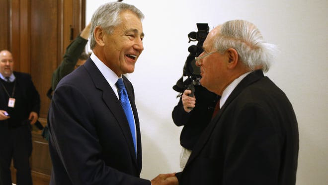 Former senator Chuck Hagel, President Obama's nominee to become Defense secretary, greets Senate Armed Services Committee Chairman Carl Levin, D-Mich., on Jan. 22.