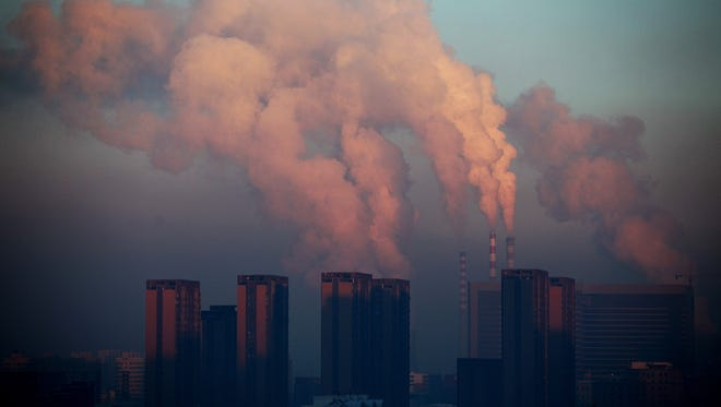 A thermal power plant discharges heavy smog into the air in Changchun, northeast China's Jilin province, on Jan 22. China has cleaned up its air before, but experts say that if it wants to avoid the kind of smog that choked the country this month, it must overhaul an economy fueled by heavily polluting coal and car use.